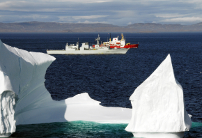 HMCS Toronto and the Canadian Coast Guard Ship (CCGS) Pierre Radisson sail past an iceberg in the Hudson Strait off the coast of Baffin Island. Photo by: Sergeant Kevin MacAulay